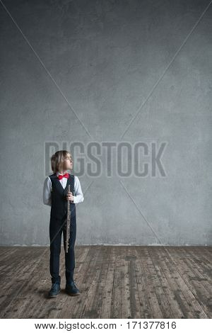 Little boy with flute in studio