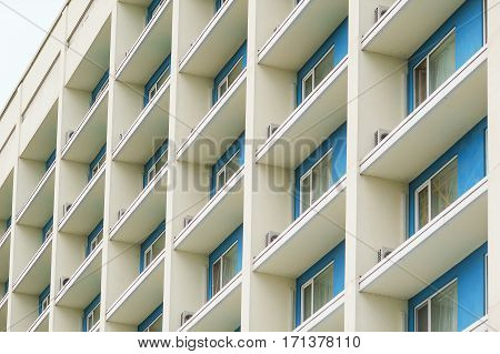 part of a modern multi-storey office building with balconies and windows.