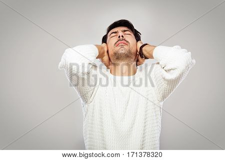 young man with closed eyes feeling pain