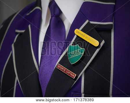 School boys blazer with three school badges