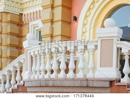 part of old architectural buildings with white balcony balustrades