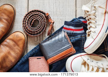Clothing and accessories on the wooden floor.