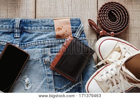 Jeans and dress on the old wooden floor.