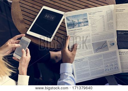 Businesspeople Reading Newspaper Using Mobile Techie