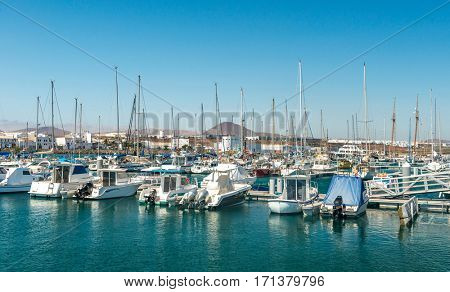 Small yachts floating in the habour in Lanzarote on a bright sunny day, Spain