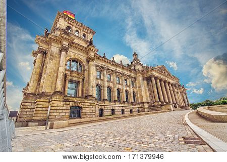 Reichstag building in Berlin Germany. Dedication on the frieze means To the German people