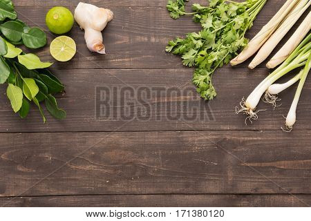 Kaffir Lime Leaves, Coriander Or Cilantro, Ginger, Lemon, Lemon Grass And Green Onions On Wooden Bac