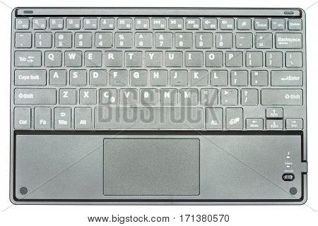 wireless bluetooth black keyboard made in plastic isolated in white background.
