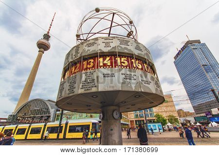 BERLIN GERMANY - JUNE 6 2012: Berlin's Alexanderplatz Weltzeituhr - World Time Clock and TV Tower in Berlin. Alexanderplatz is the central transportation hub of Berlin