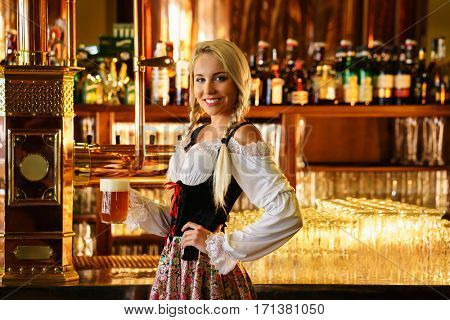 Young waitress with beers in a bar