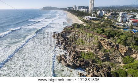 Aerial view of Miami Headland facing south looking towards Burleigh beach and headland. Gold Coast, Australia