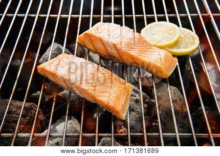 Grilled Salmon With Lemon On The Flaming Grill