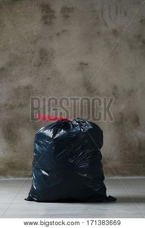 Pollution. Trash bag on the floor