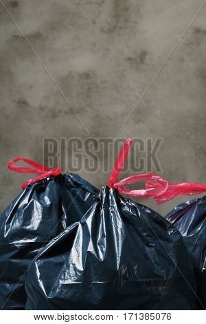 Pollution. Trash bags on the floor