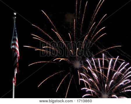 Us Flag With Gold And Silver Fireworks