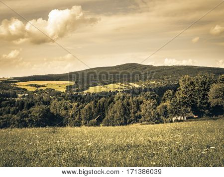 Middle European countryside, Czech republic, Jeseniky in summer, meadow under the Mala Destna mountain, nostalgic aged photo feeling