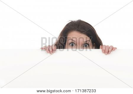 Young scary woman holding white board for advertisement