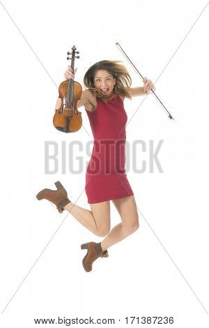 Young woman jumping high with violin music instrument isolated over white background