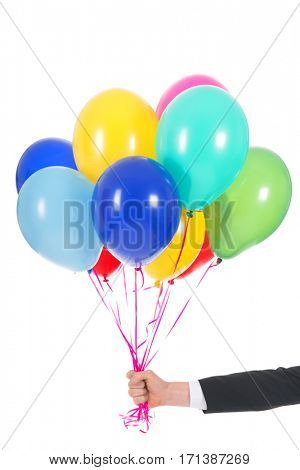 Male hand with bunch of colorful balloons