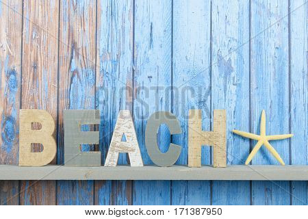 Blue wooden background with vintage beach text