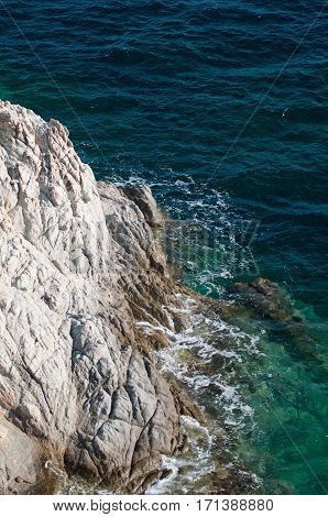 Steep cliff on the sea shore, color image