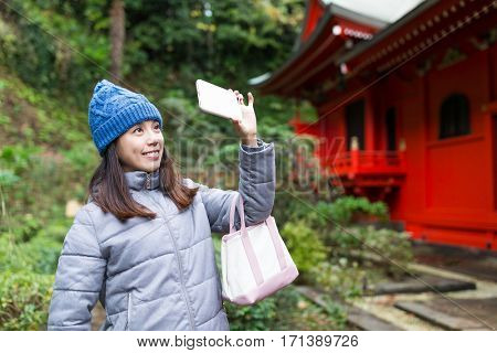 Woman taking selfie in kamakura