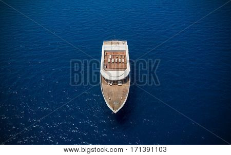 Aerial view of big luxury yacht in sea, copyspace for text