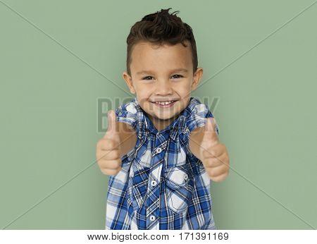Little Boy Thumb up Studio Portrait Concept