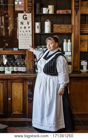 TELFORD UK - CIRCA 2013: An actor at Blists Hill Victorian Museum poses as a pharmacist in a traditional apothecary. Ironbridge UK