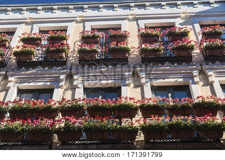 Leon (Castilla y Leon Spain): historic building in Calle Ancha with balconies and flowers