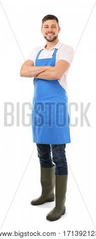 Handsome gardener in blue apron isolated on white background