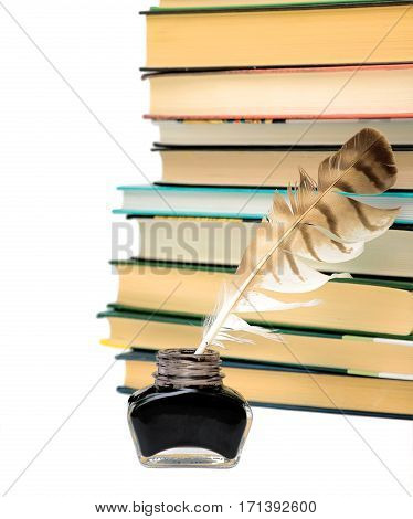 ink pen and stack of books on a white background. horizontal photo.