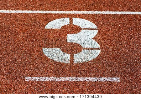 Start number three at cinder track of track and field running track