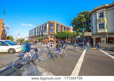 San Francisco, California, United States - August 14, 2016: People running tour by bike in Beach street and Hyde rd cross corner at Fisherman's Wharf district. San Francisco cityscape street view.
