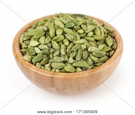 Cardamon in wooden bowl isolated on white background with clipping path