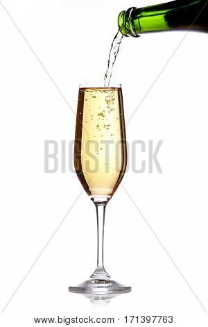 Pouring champagne in one flute on white ground