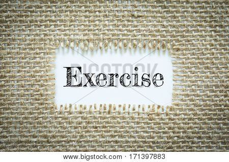 Text Exercise on paper white has Cotton yarn background you can apply to your product.