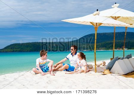 Family father and kids enjoying tropical beach vacation