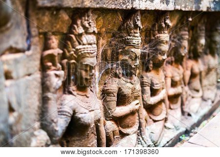 Ancient stone carvings at Terrace of the Leper King in Angkor Thom, Siem Reap, Cambodia