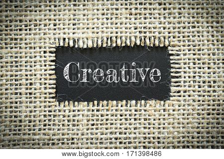 Text Creative on paper black has Cotton yarn background you can apply to your product.