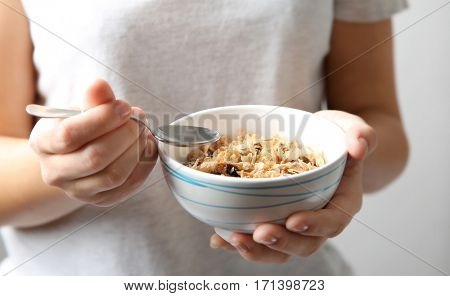 Closeup of woman holding bowl with healthy breakfast