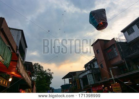 PINGXI, TAIWAN - FEBRUARY 11, 2017 - Lanterns rise into the sky at the 2017 Pingxi Sky Lantern Festival in Taiwan