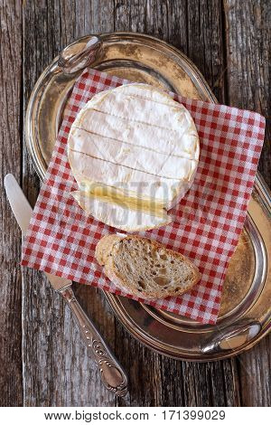 French Camembert cheese on slice of bread. Top viev