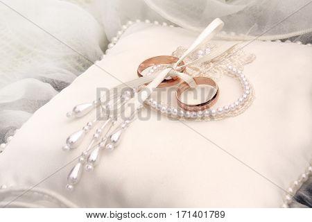Two golden wedding rings on silk. Wedding background