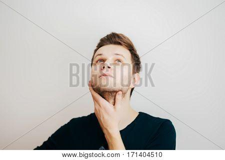 Portrait of a caucasian man hiding his face