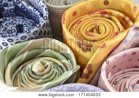 Closeup colorful neck tie rolls for sale