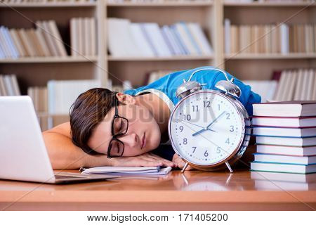 Young student preparing late for his exams