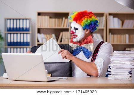 Clown businessman working in the office