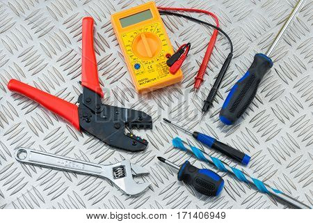 Electrician's Tools And Equipment On Steel Tread Plate