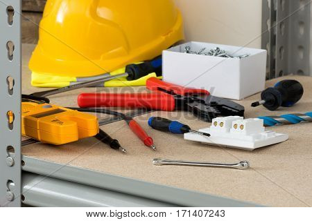 Electrical Tools And Supplies On Cork-covered Shelving